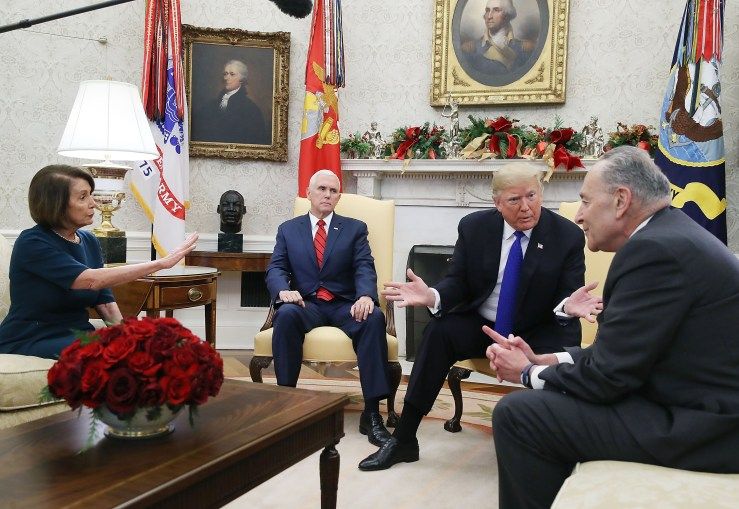 U.S. President Donald Trump (2nd from right) argues about border security with Senate Minority Leader Chuck Schumer (right) and House Minority Leader Nancy Pelosi as Vice President Mike Pence sits nearby in the Oval Office on December 11, 2018 in Washington, DC. (Photo by Mark Wilson/Getty Images)