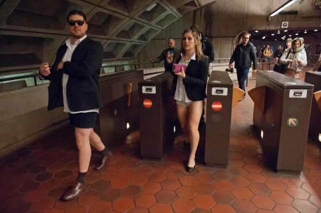 """People taking part in the """"No Pants Subway Ride"""" enter a metro station in Washington on January 12, 2014. """"No Pants Subway Ride"""" is an annual event in which transit passengers ride trains without wearing pants in January. The event is observed in dozens of cities worldwide. (Photo: NICHOLAS KAMM/AFP/Getty Images)"""