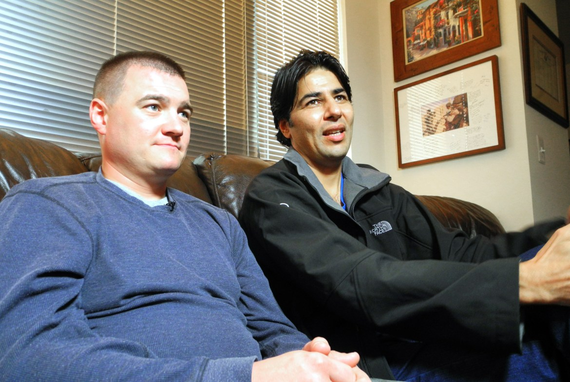 U.S. Army Captain Matt Zeller (L) with translator Janis Shenwari, whom he credits for saving his life in a firefight in Afghanistan in November 2008, and who, after 5 years of struggle, is one of the lucky few who was able to take advantage of the special Visa program for Afghanistan interpreters.(Guillaume Meyer/AFP/Getty Images)