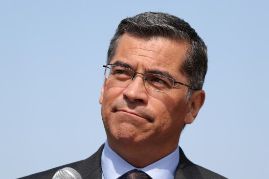 California Attorney General Xavier Becerra speaks about President Trump's proposal to weaken national greenhouse gas emission and fuel efficiency regulations, at a media conference in Los Angeles