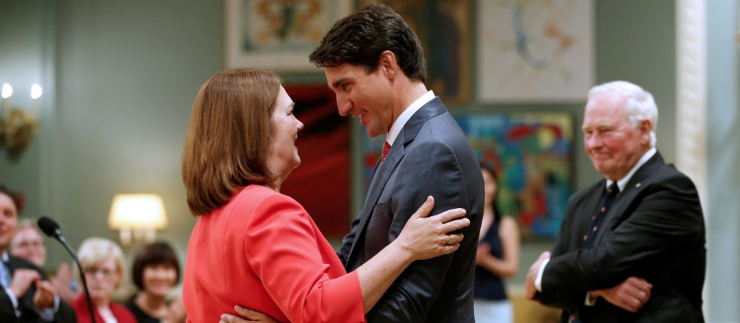 FILE PHOTO: Canada's Prime Minister Justin Trudeau (R) congratulates Jane Philpott after she was sworn-in as Canada's Minister of Indigenous Services during a cabinet shuffle at Rideau Hall in Ottawa, Ontario, Canada, August 28, 2017. REUTERS/Chris Wattie/File Photo
