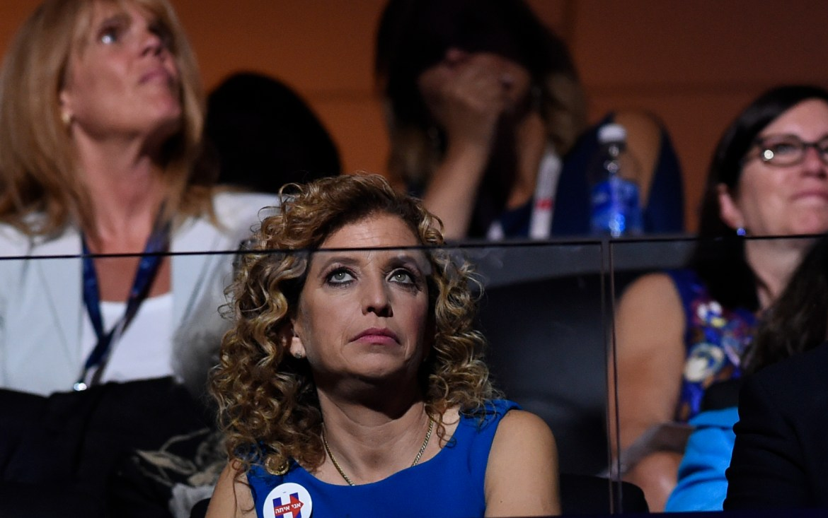 Former chairperson of the Democratic National Committee Debbie Wasserman Schultz listens to the biographical film presentation of Democratic presidential nominee Hillary Clinton during the fourth and final night of the Democratic National Convention at Wells Fargo Center on July 28, 2016 in Philadelphia, Pennsylvania. (SAUL LOEB/AFP/Getty Images)