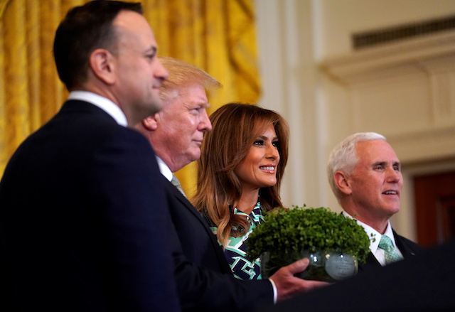 U.S. President Donald Trump, first lady Melania Trump and Vice President Mike Pence take part in the Shamrock Bowl presentation from Irish Taoiseach Leo Varadkar (L) at the White House in Washington, U.S., March 14, 2019. REUTERS/Kevin Lamarque