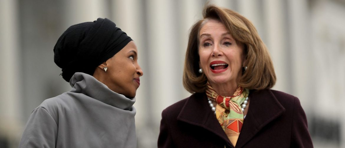 WASHINGTON, DC - MARCH 08: Rep. Ilhan Omar (D-MN) (L) talks with Speaker of the House Nancy Pelosi (D-CA) during a rally with fellow Democrats before voting on H.R. 1, or the People Act, on the East Steps of the U.S. Capitol March 08, 2019 in Washington, DC. (Photo by Chip Somodevilla/Getty Images)