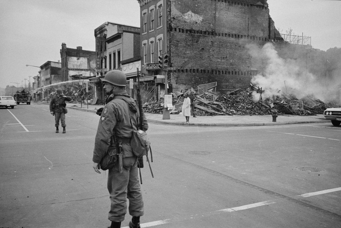 A soldier standing guard with the ruins of buildings that were destroyed during the riots that followed the assassination of Martin Luther King, Jr., in this April 8, 1968 photograph (Library of Congress/Handout via Reuters/Reuters)