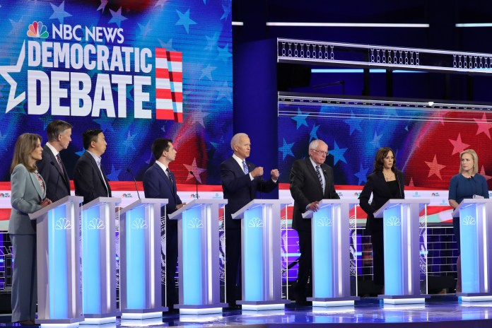 Democratic presidential candidates Marianne Williamson, former Colorado governor John Hickenlooper, former tech executive Andrew Yang, South Bend, Indiana Mayor Pete Buttigieg, former Vice President Joe Biden, Sen. Bernie Sanders, Sen. Kamala Harris, and Sen. Kirsten Gillibrand take part in the second night of the first Democratic presidential debate on June 27, 2019 in Miami, Florida. (Photo by Drew Angerer/Getty Images)