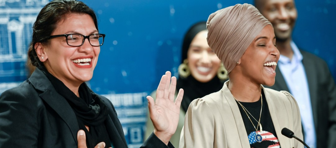 U.S. Representatives Rashida Tlaib (D-MI) and Ilhan Omar (D-MN) react as they discuss travel restrictions to Palestine and Israel during a news conference at the Minnesota State Capitol Building in St Paul, Minnesota, August 19, 2019. REUTERS/Caroline Yang