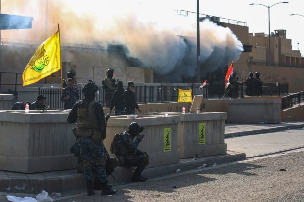 Iraqi security forces are deployed in front of the US embassy in the capital Baghdad, after an order from the Hashed al-Shaabi paramilitary force to supporters to leave the compound on January 1, 2020. - Thousands of Iraqi supporters of the largely Iranian-trained Hashed had encircled and vandalised the embassy compound yesterday, outraged by US air strikes that killed 25 fighters of the military network over the weekend.(Photo by AHMAD AL-RUBAYE/AFP via Getty Images)