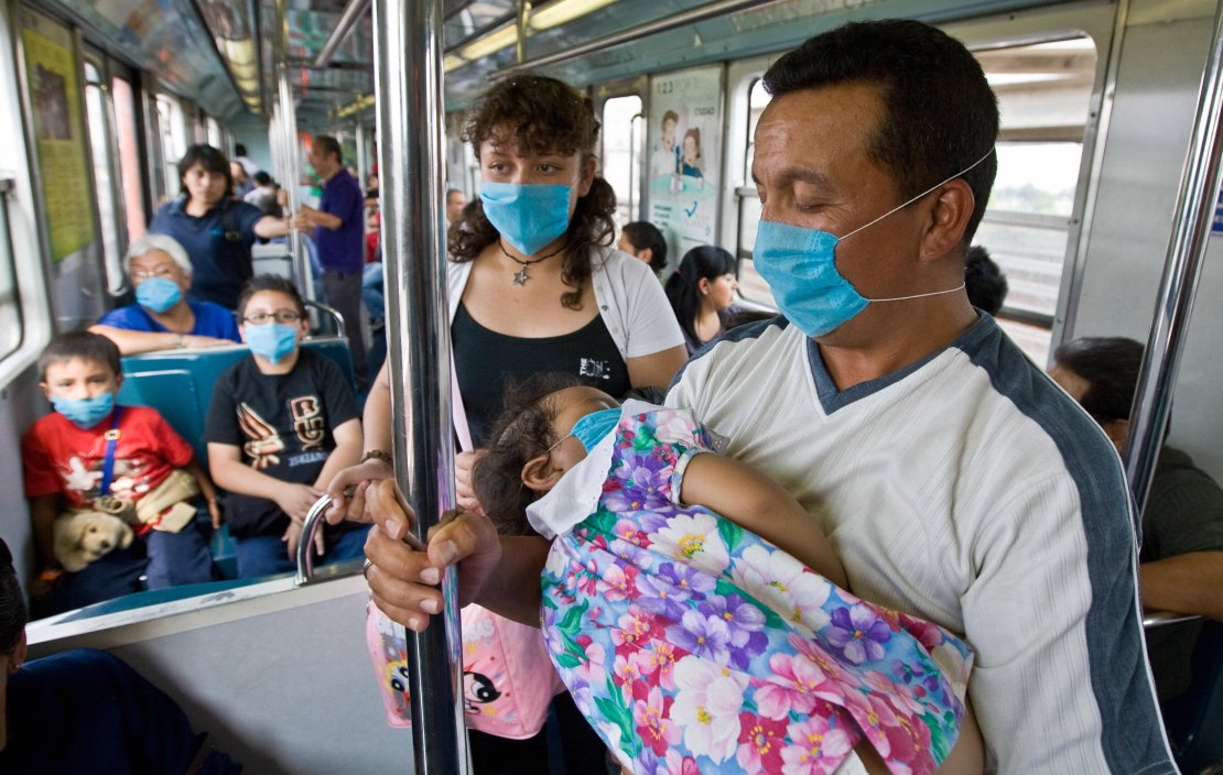 Commuters wear face masks to prevent the infection by the swine flu virus in while travelling aboard Mexico City's subway. (Ronaldo Schemidt/AFP via Getty Images)