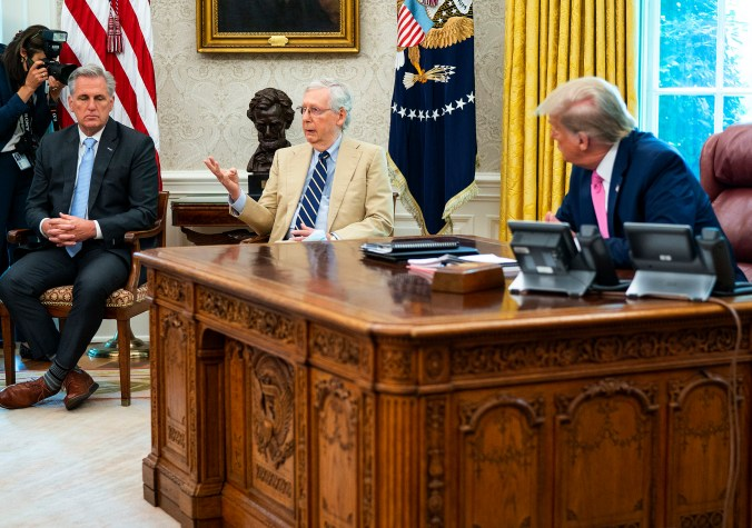WASHINGTON, DC - JULY 20: U.S. President Donald Trump listens to Senate Majority Leader Mitch McConnell (R-KY) (C) during a meeting with cabinet members and House Minority Leader Kevin McCarthy (R-CA) (L) in the Oval Office at the White House July 20, 2020 in Washington, DC. Trump and the congressional leaders talked about a proposed new round of financial stimulus to help the economy during the ongoing global coronavirus pandemic. (Photo by Doug Mills/Getty Images)