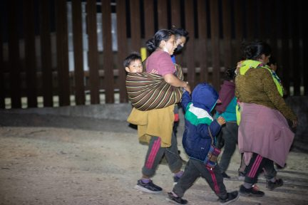 A group of migrants sought out law enforcement officials so they could turn themselves in and try to apply for asylum near the Hidalgo Point of Entry on August 9, 2021. (Kaylee Greenlee - Daily Caller News Foundation)