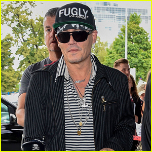 Johnny Depp Greets Fans While Arriving at Poland Airport