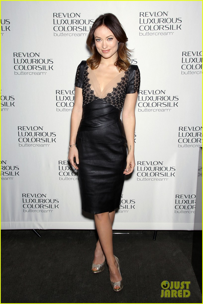 Olivia Wilde wearing a Talbot Runhof dress, Nicholas Kirkwood heels, and Iwona Ludyga jewelry at the 2013 Revlon Luxurious ColorSilk Buttercream launch
