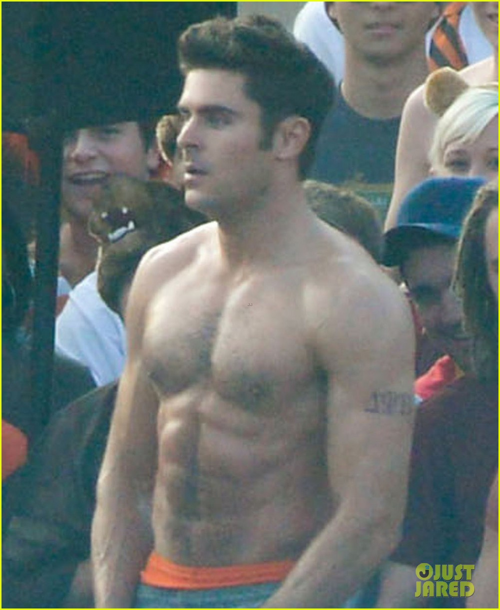 zac efron sticks hand in shorts flaunts eight pack abs 06
