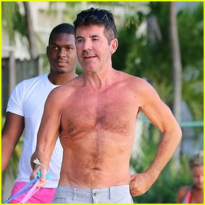 Simon Cowell Goes Shirtless for Dog Walk on Barbados Beach