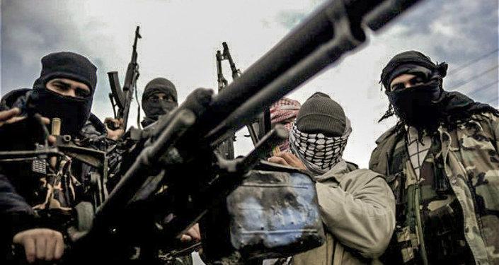 Syrian rebel army patrol an area near Homs