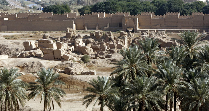 A view of the newly constructed (back) and ruins (foreground) of the ancient city of Babylon, some 100 kms south of Baghdad, on November 27, 2008