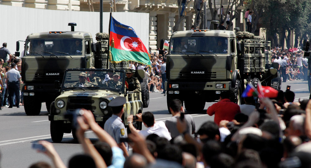 Military vehicles make their way down a road during a military parade marking Armed Forces Day in Baku, Azerbaijan, in 2011.