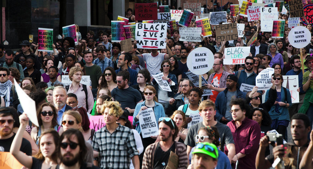 Protestors march Wednesday, April 29, 2015, in Baltimore.