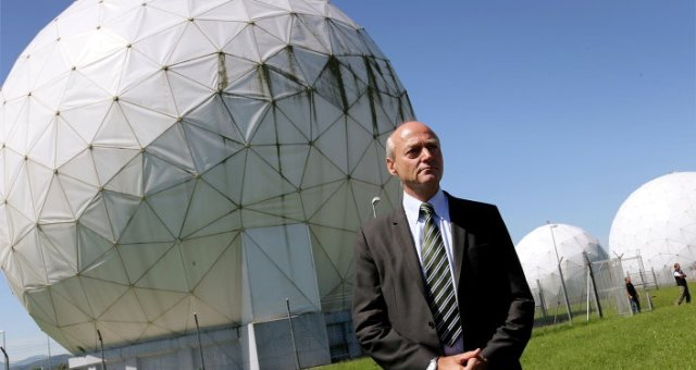 The president of German Intelligence Agency (BND) Gerhard Schindler stands in front of the giant golf ball-shaped radomes in Bad Aibling, near Munich , Germany, Friday June 6, 2014.