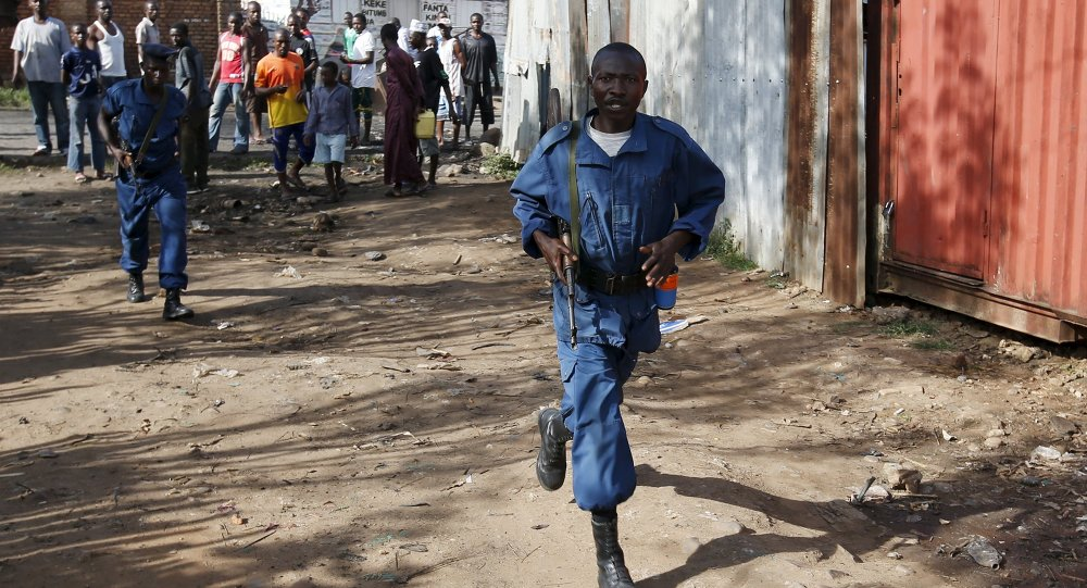Policemen walk along a street in Bujumbura, Burundi May 15, 2015