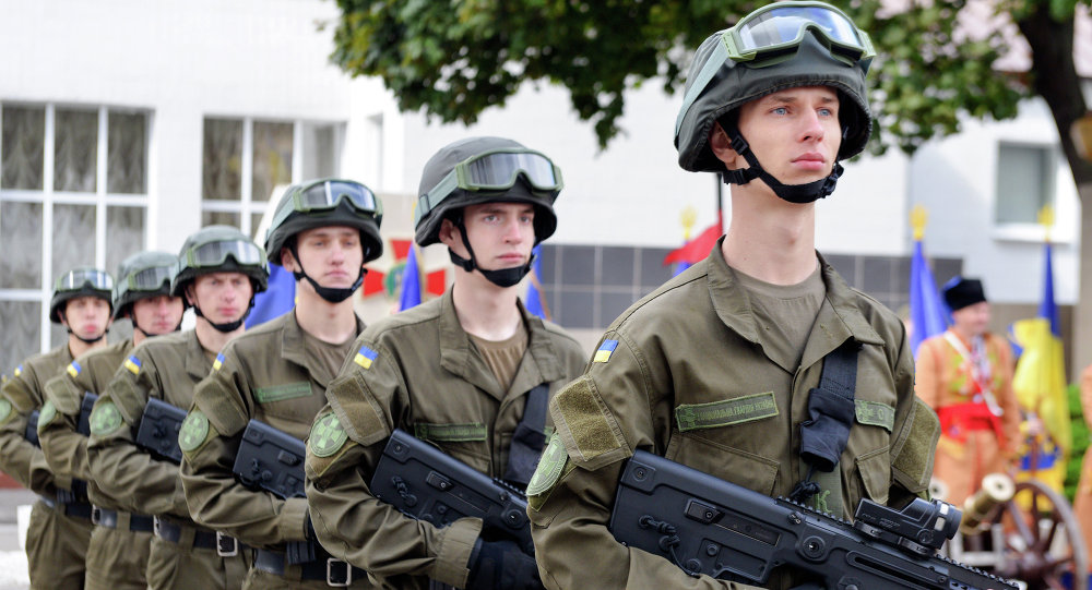 Servicemen of the Ukrainian National Guard stand at attention during a ceremony of oath at the Academy of the National Guard in Kharkiv, on May 16, 2015