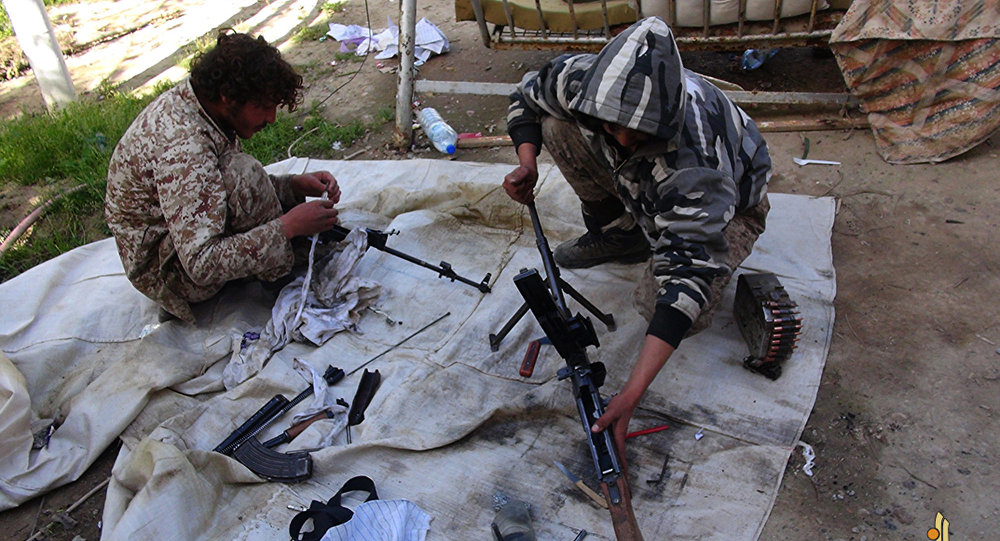 In this file photo released on June 16, 2015, by Ismamic State militant group supporters on an anonymous photo sharing website, Islamic State militants clean their weapons in Deir el-Zour city, Syria