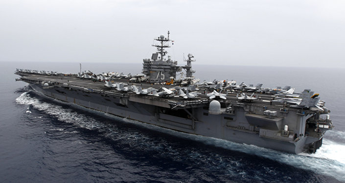 A general view shows the nuclear-powered aircraft carrier USS Harry S. Truman at an undisclosed position in the Mediterranean Sea, south of Sicily, Monday June 14, 2010.