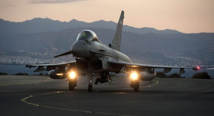 A British Royal Air Force Eurofighter Typhoon fighter jet is seen on the tarmac at the British airbase at Akrotiri, near Cyprus' second city of Limassol on December 3, 2015