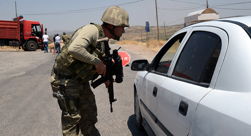 Turkish soldier checks cars at a checkpoint (File)