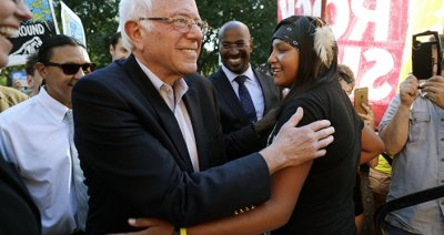 Sen. Bernie Sanders, I-Vt., left, greets Jasilyn Charger, a member of the Cheyenne River Sioux Tribal Youth Council, after Charger spoke to a group of supporters of the Standing Rock Sioux Tribe who were rallying in opposition of the Dakota Access oil pipeline, during a rally by the White House, Tuesday, Sept. 13, 2016, in Washington. Sanders also spoke at the rally.