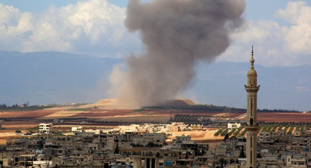 Smoke raises in the Syrian village of Kafr Ain in the southern countryside of Idlib province after an airstrike on September 7, 2018