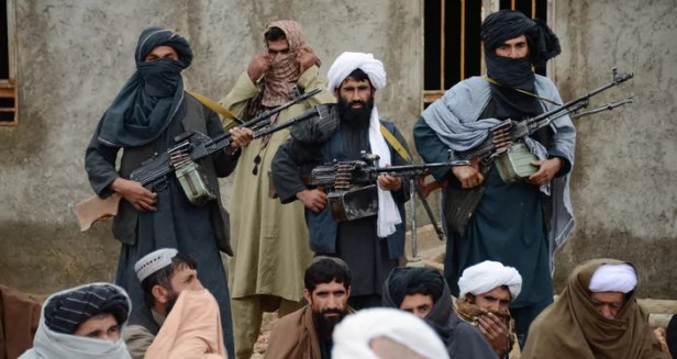 In this Tuesday, 3 November 2015 photo, Afghan Taliban fighters listen to Mullah Mohammed Rasool, unseen, the newly-elected leader of a breakaway faction of the Taliban, in Farah province, Afghanistan