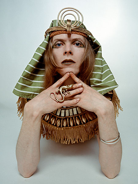 Bowie posing in costume