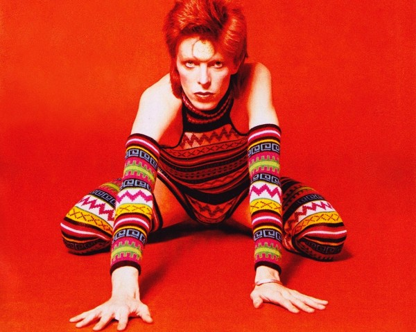Bowie posing in stripy leotard