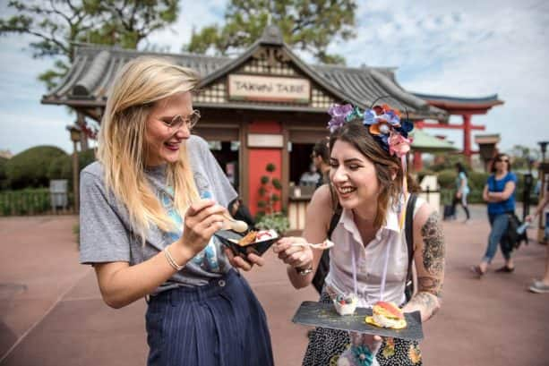 Sampling food during Epcot International Festival of the Arts