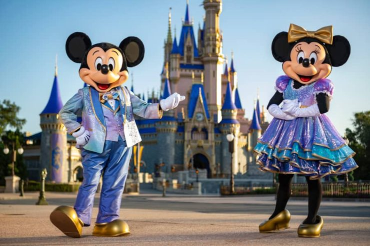 """Mickey Mouse and Minnie Mouse, wearing sparkling new looks for """"The World's Most Magical Celebration"""" in honor of Walt Disney World Resort's 50th anniversary"""