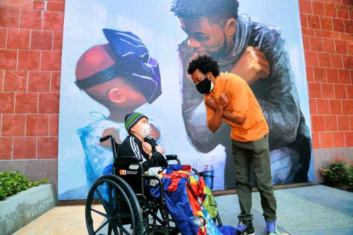 Artist Nikkolas Smith with CHLA cancer patient Daniel, 11 Courtesy of Children's Hospital Los Angeles