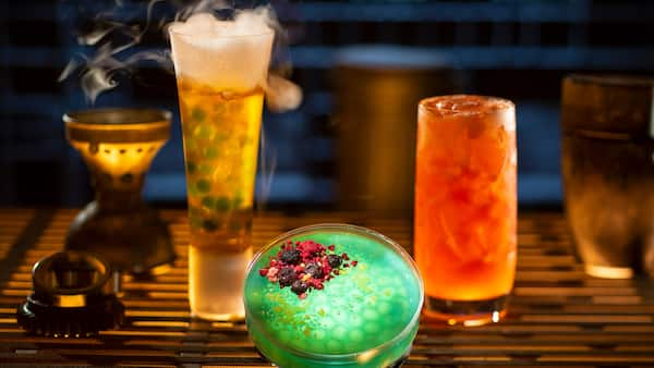 Unusual glasses are filled with specialty cocktails