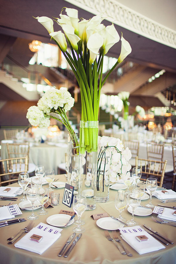 Dramatic modern centerpieces filled with fresh white calla ...