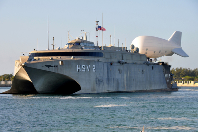 The_high-speed_vessel_swift__hsv-2__gets_underway_with_a_tethered_tif-25k_aerostat_balloon_in_key_west__fla