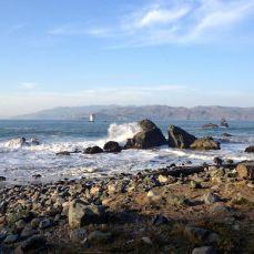 Waves crash at Mile Rock Beach