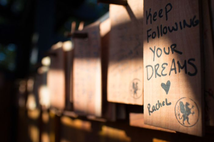 The shingles are each stamped with one of several patterns, and visitors are encourage to write their wish down on and hang it on one of the pegs lining the inside of the tea house.