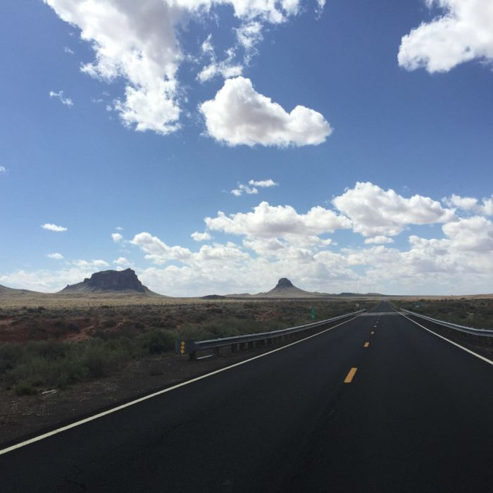 Driving through Arizona badlands on a solo road trip
