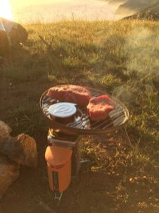 Grilling steaks on the BioLite stove with grill