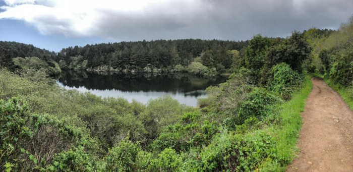 The first of several lakes you pass on the Coast Trail