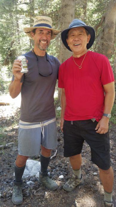 Paul gives Mark a beer