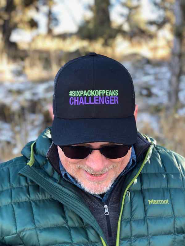 Looking sharp in a Six-Pack of Peaks Trucker Hat