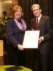 Volunteer Leadership Awardee Nancy Lukitsh, MBA '80, with Dean Julio Frenk.