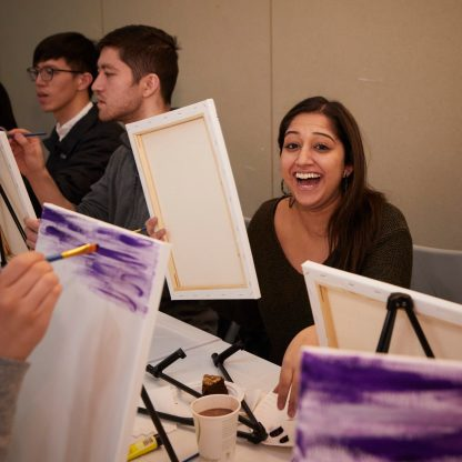 Student laughing at paint night